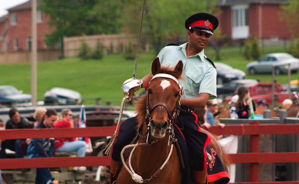 Akaash Maharaj rides for Canada in Equestrian Skill-at-Arms
